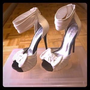 White leather Bebe bow tie heels